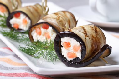 Eggplant rolls stuffed with cream cheese and tomatoes