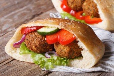 falafel with vegetables in pita bread  closeup horizontal