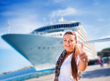 Young woman near cruise ship