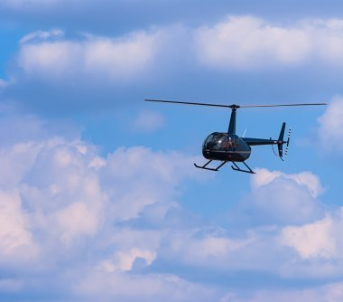 Civilian helicopter in the sky