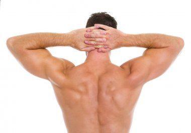 Strong athletic man showing muscular back