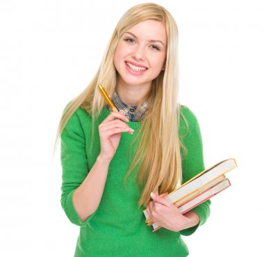 Smiling student girl with books and pen