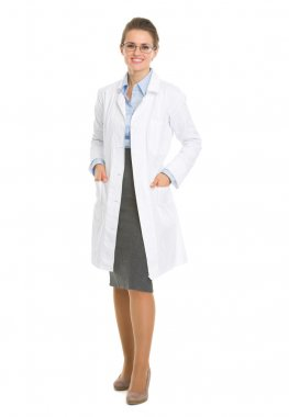 Full length portrait of smiling ophthalmologist doctor woman in