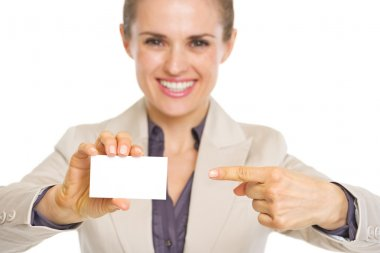Closeup on smiling business woman pointing on business card stock vector
