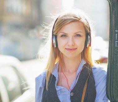 Hipster girl listening music