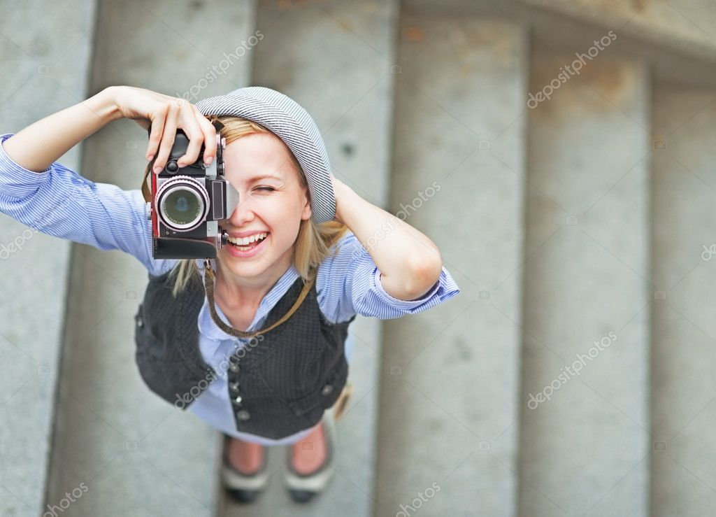 girl making photo with retro camera