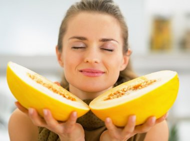 Young woman enjoying melon