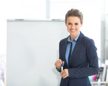 Business woman near flipchart