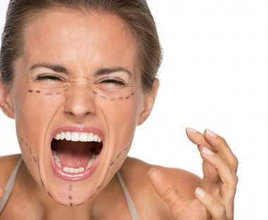 Stressed woman with plastic surgery marks