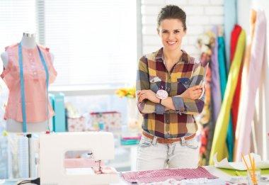 Happy seamstress in studio