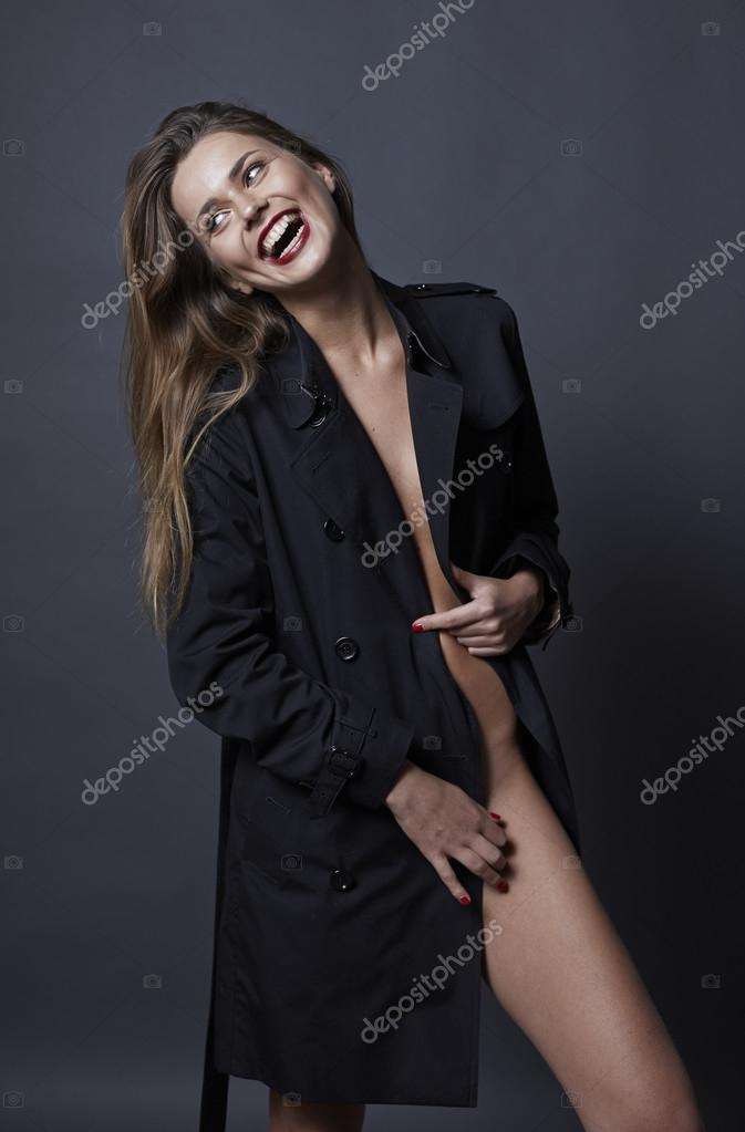 ac825f98c0f6 Gorgeous smiling woman in fashionable trench coat half naked — Stock ...