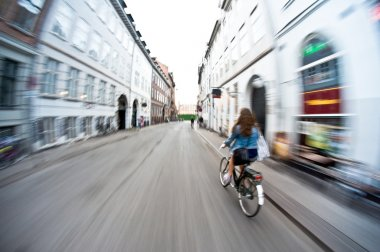 Riding bicycle in the city, motion blur