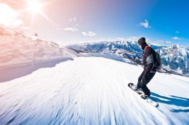 Snowboarder riding fast, motion blur, fisheye shot stock vector