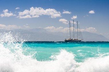 Sailship cruising dangerous seas, big waves