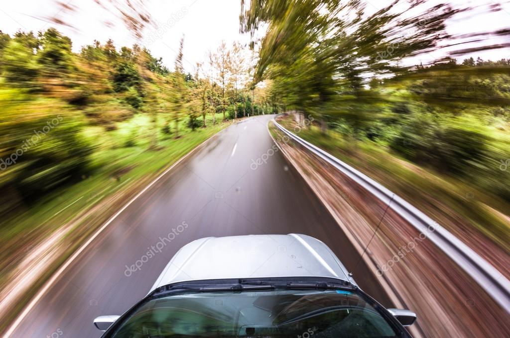 Car driving fast, fisheye photo