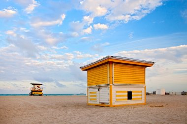 Summer scene in Miami Beach Florida, with a colorful lifeguard house in a typical Art Deco architecture