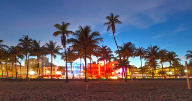 Miami Beach, Florida hotels and restaurants at sunset on Ocean Drive