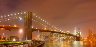 New York City night panorama with Brooklyn Bridge
