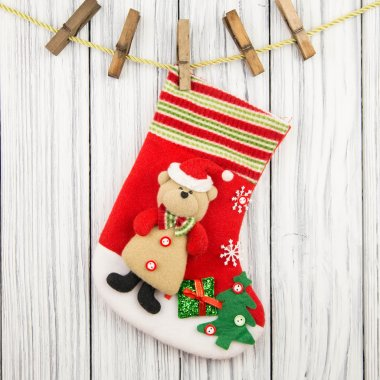 Christmas gifts for his boots isolated on wood background