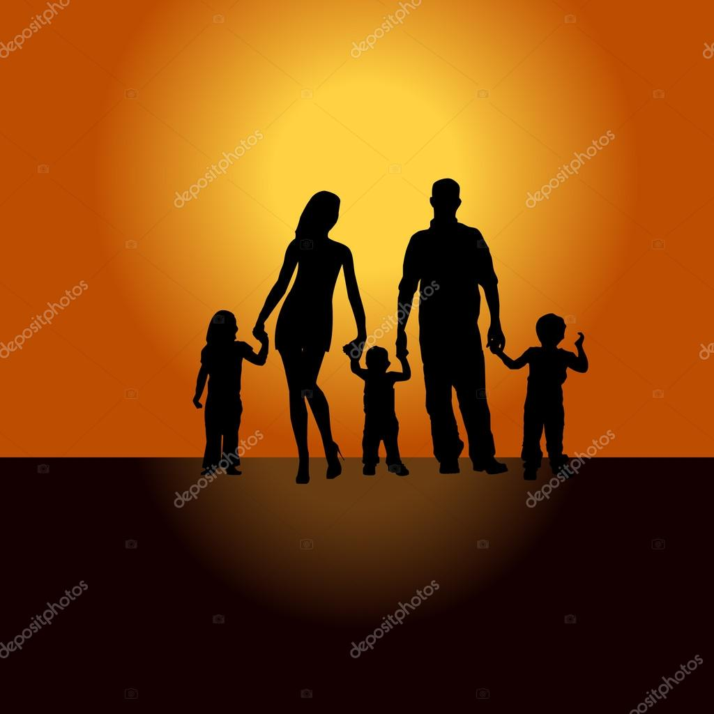 Family silhouette mother father child at sunset.