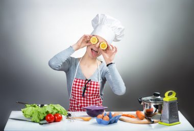 Crazy cooking woman with lemon eyes