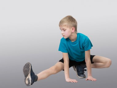 Sportive boy stretching his leg