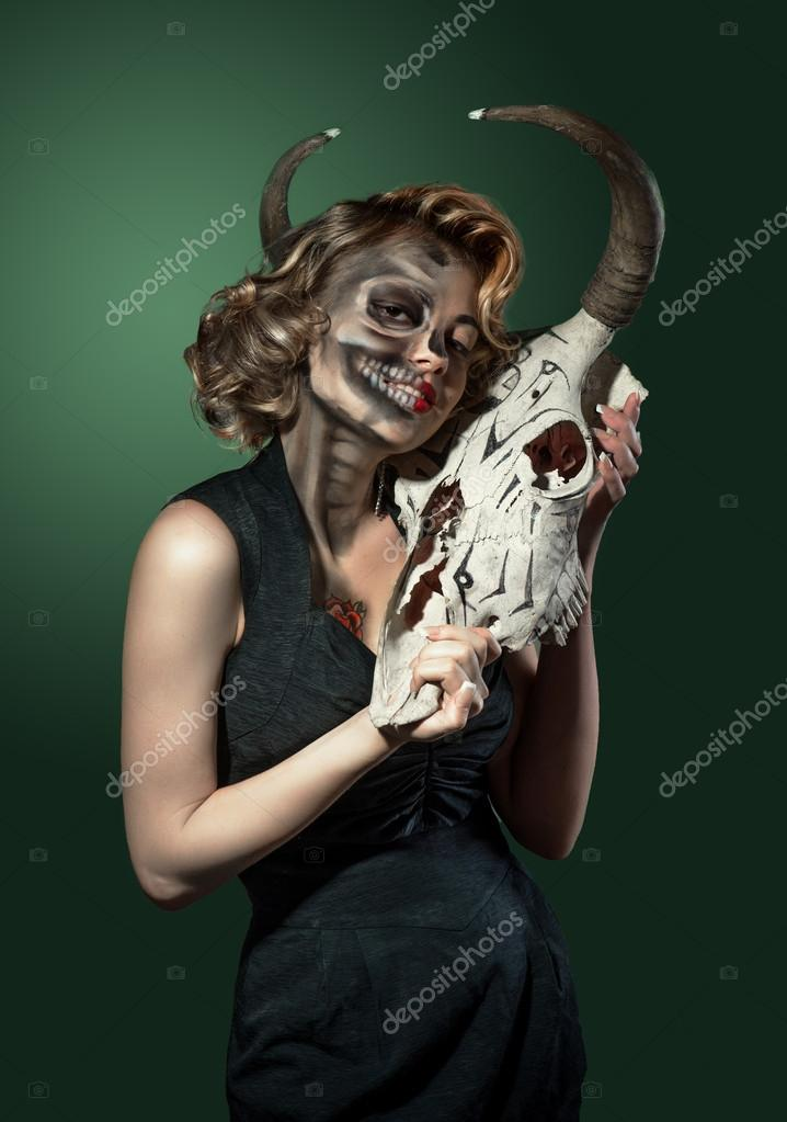 Portrait of a woman with cow's skull in her hands