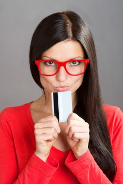 Portrait of a woman with a plastic card