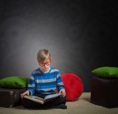 Preteen boy reading a book