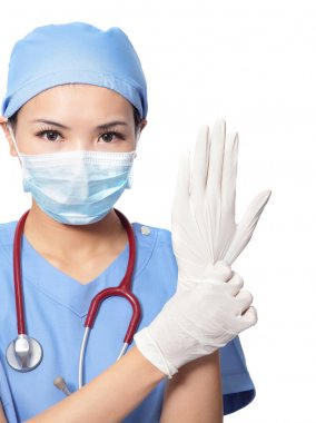 Woman doctor wearing medical gloves