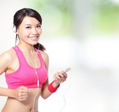 sport woman listen music