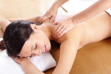 Woman having massage of shoulder