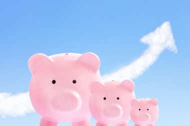 pink piggy banks with sky and cloud arrow