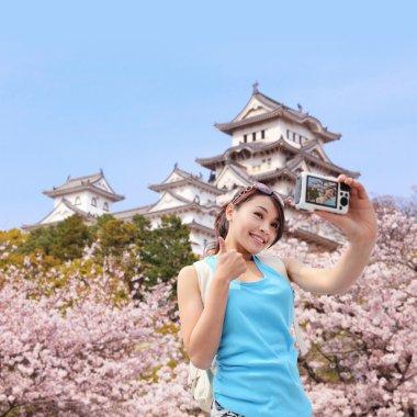 Happy woman traveler take a photo