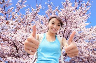 Happy woman traveler show thumb up