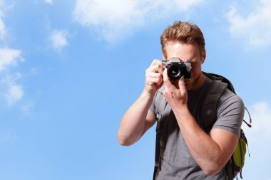 Young man taking photo