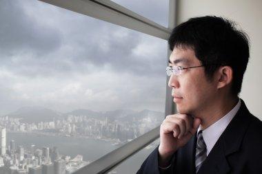 Business man look city through window