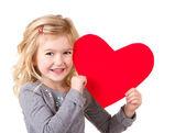 Fotografie Kleines Mädchen hält Herz