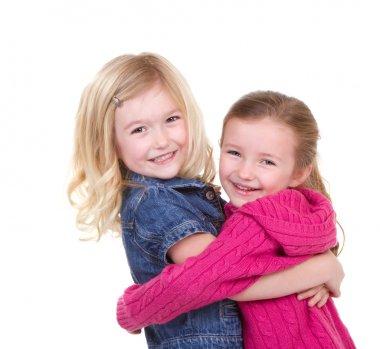 two girl children hugging