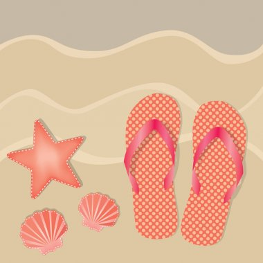 Flip flops or sandals with orange polka dots on a sandy beach