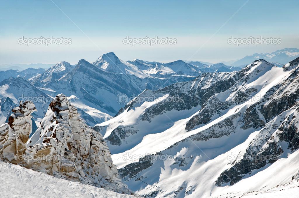 Scenic wallpaper from high mountain in Austrian Alps during peak ski season