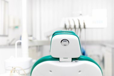 Dentist office with tools, professional dentist chair and equipment at local dental clinic