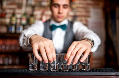 barman preparing shots for cocktail party on bar