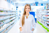 Fotografie pharmacist chemist woman standing in pharmacy drugstore