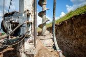 Fotografie Nahaufnahme Auger, industrielle Bohranlage machen ein Loch in den Boden