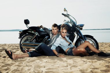 Couple resting on beach - travel destination