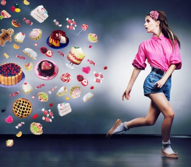 Escape. Resolute running woman refuses to eating tasty cakes and chocolate. Diet concept