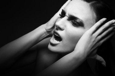 Sad woman yelling - migraine. Depression, stress