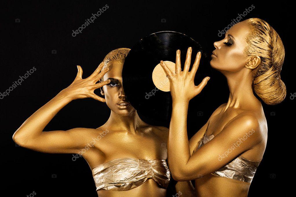 Fetish. Women DJs holding Retro Vinyl Record. Fantastic Gold Badyart. Performance