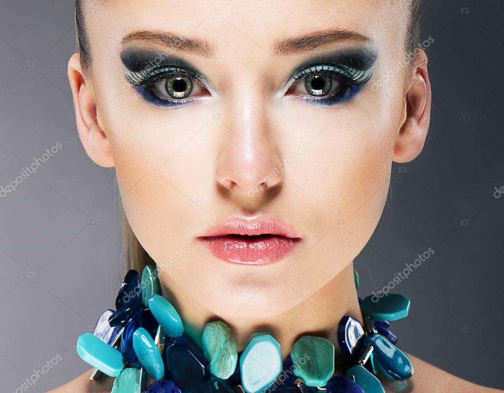Glamorous Confident Woman in Semi Precious Turquoise Necklace close up